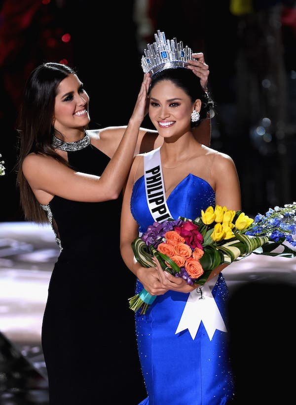 LAS VEGAS, NV - DECEMBER 20: Miss Philippines 2015, Pia Alonzo Wurtzbach (R), reacts as she is crowned the 2015 Miss Universe by Miss Universe 2014 Paulina Vega (L) during the 2015 Miss Universe Pageant at The Axis at Planet Hollywood Resort & Casino on December 20, 2015 in Las Vegas, Nevada. Miss Colombia 2015, Ariadna Gutierrez (not pictured), was mistakenly named as Miss Universe 2015 instead of first runner-up. (Photo by Ethan Miller/Getty Images)
